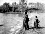 First Nations woman and child